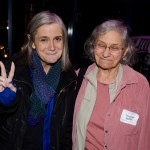 Amy Goodman flashes a peace sign while talking to Charlotte Phillips, Chair of Brooklyn For Peace.